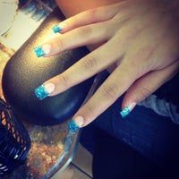 Photo taken at Pretty Nails by Debbiie W. on 4/13/2013