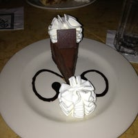 Photo taken at The Cheesecake Factory by Ricki D. on 1/6/2013