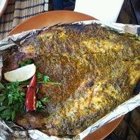 Photo taken at Al Muhallab Restaurant by Adora H. on 6/18/2013