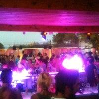 Photo taken at Bikini Beach Bar by Fotis N. on 8/4/2013