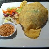 Photo taken at Pi-Tom's Thai Cuisine by Astrid S. on 3/22/2014