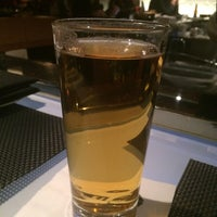 Photo taken at Wolfgang Puck Grille by Jack B. on 3/28/2014