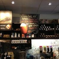 Photo taken at Starbucks by j y. on 9/12/2013