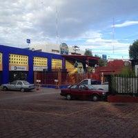 Photo taken at Plaza 2000 (Milenio) by Manuel M. on 9/30/2014