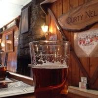 Photo taken at Dürty Nelly's Pub  & Wayside Deli by PJ C. on 4/23/2014