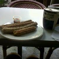 Photo taken at La Azteca Churros & Café by Eli S. on 11/21/2011