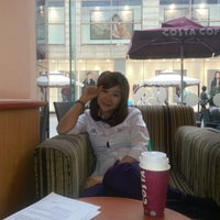 Photo taken at Costa Coffee (咖世家) by Bill B. on 10/23/2012