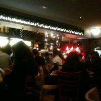 Photo taken at Caffé Sienna Ristorante by Warwick G. on 10/27/2012