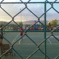 Photo taken at Bostanlı Basketbol Sahası by Cem N. on 6/15/2013