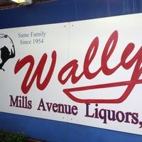 Photo taken at Wally's Mills Avenue Liquors by Chris G. on 11/9/2013