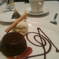 Photo taken at Opus 9 Steakhouse by Erica R. on 5/15/2015