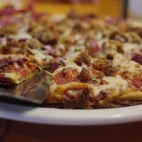 Photo taken at Uno Pizzeria & Grill - Birch Run by Aaron B. on 6/25/2013
