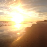 Photo taken at Atlantic Beach by Aaron B. on 12/22/2012