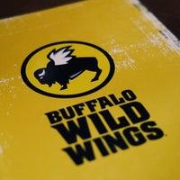 Photo taken at Buffalo Wild Wings by Aaron B. on 8/11/2013