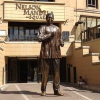 Photo taken at Nelson Mandela Square by Amy T. on 1/26/2013