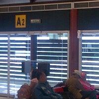Photo taken at Gate A2 by Heru B. on 11/30/2013