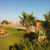 Photo taken at Zuga Beach Club by I . on 7/28/2013