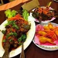 Photo taken at Rumah Thai Restaurant by Nurulhusna M. on 7/29/2013