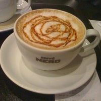 Photo taken at Caffé Nero by Berra G. on 11/29/2012