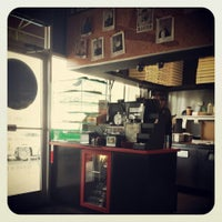 Photo taken at Tomasino's Pizza by Emily S. on 7/11/2013