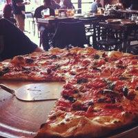 Photo taken at Grimaldi's Coal Brick-Oven Pizza by Carolina C. on 10/6/2012