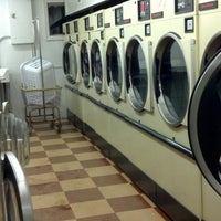 Photo taken at Coins Laundromat by Kalue on 6/23/2013