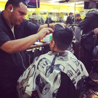 Photo taken at Extravagant Cuts Barber Shop by Yasmin A. on 11/14/2015