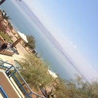 Photo taken at Dead Sea Beach (Holiday Inn Resort) by Sam A. on 6/18/2015