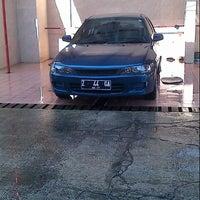 Photo taken at Cikopo Car Wash by Angga A. on 9/21/2013