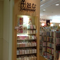 Photo taken at 包むファクトリー 大阪ルクア店 by heresy666 on 1/4/2013