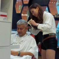 Photo taken at Peek-a-boo Hair Salon by Juan H. on 2/8/2014