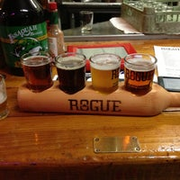 Photo taken at Rogue Ales Brewer's on the Bay by Avery S. on 12/15/2012