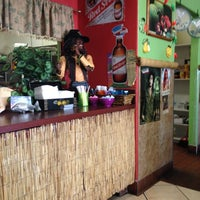 Photo taken at Mama Jamaica's Kitchen by Justin C. on 10/1/2012