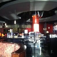 Photo taken at Glo Restaurant & Lounge by Cori S. on 11/14/2012
