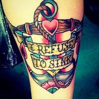 Photo taken at Jade Dragon Tattoo and Exotic Body Piercing Studio by Amanda W. on 4/12/2013