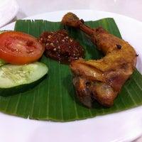 Photo taken at Kafe Betawi by Sueka P. on 12/15/2012