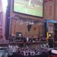 Photo taken at Bikinis Sports Bar & Grill by Steve D. on 6/26/2013