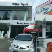 Photo taken at Wijaya Toyota-Dago by Susianne S. on 3/7/2014