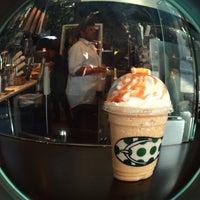 Photo taken at Starbucks by Olga S. on 7/9/2015