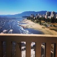 Photo taken at Burrard Bridge Dog beach by Fernanda P. on 7/31/2014
