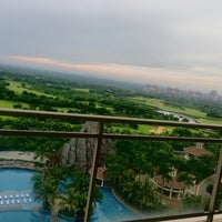Photo taken at Mission Hills Hainan by Amy Y. on 7/11/2016