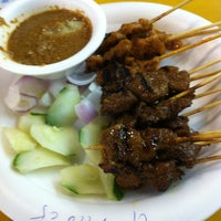 Photo taken at Chomp Chomp Food Centre by Rachel on 2/26/2013