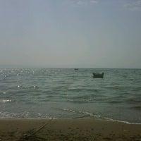 Photo taken at Palmiye Kumsal by Volkan K. on 9/17/2012