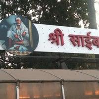 Photo taken at Shirdi Sai Baba Temple (Samadhi Mandir) by Rishi C. on 12/22/2012