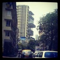 Photo taken at Peddar Road by Kamesh U. on 4/22/2013