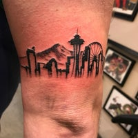 Photo taken at Under the Needle Tattoos by Dan W. on 12/10/2016