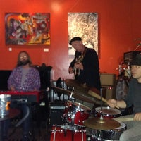 Photo taken at Revolution Cafe by Ram J. on 10/12/2013