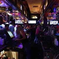 Photo taken at Dicey Riley's Irish Pub Bar by Adam S. on 1/11/2013