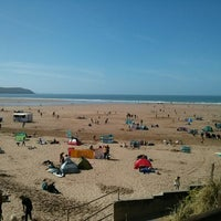 Photo taken at Woolacombe Beach by Matthew P. on 4/14/2014