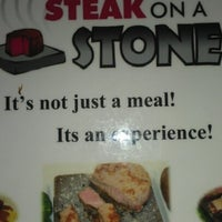 Photo taken at Steak On A Stone by Nicole S. on 10/28/2012